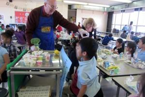 Extension Master Gardener volunteer Ken Meeks hands out broccoli samples at Oak Hill Elementary's cafeteria taste-test. (photo: JJ Richardson/CEFS)