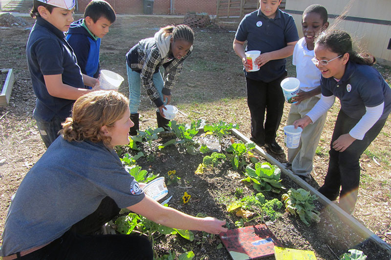 Watering the greens at Oak Hill Elementary's school garden. (photo: JJ Richardson/CEFS)