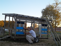 Busha building new chicken houses at the Small Farm Unit.