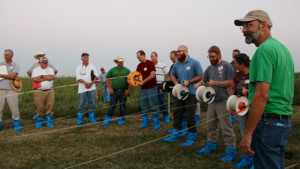 Dr. Matt Poore watches as participants race to see who can reel in their line of electric fencing the fastest. Electric fencing demonstrations are a major component of the Amazing Grazing workshops. Photo by Sarah Lyons